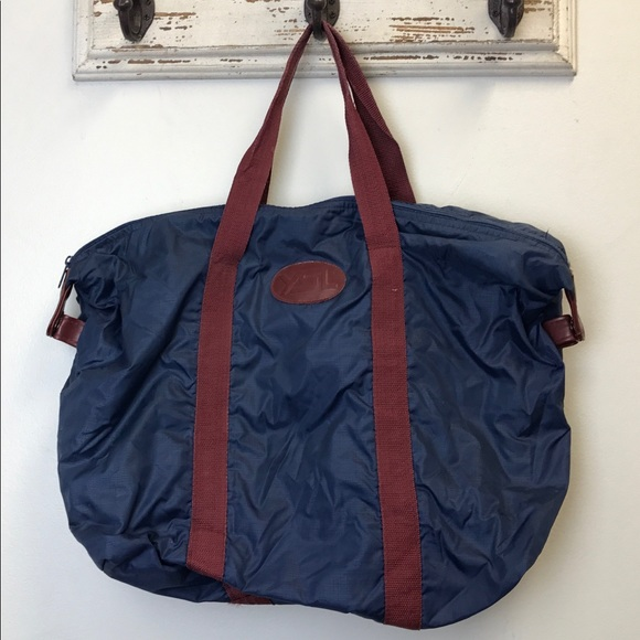Yves Saint Laurent YSL Vintage Blue Duffle Bag. M 5abfea84f9e50194f5461f02 a49200dc8a28d